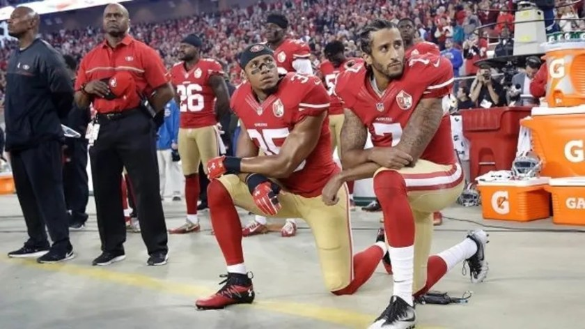 Eric Reid, left, kneels before the national anthem alongside Colin Kaepernick in 2016.