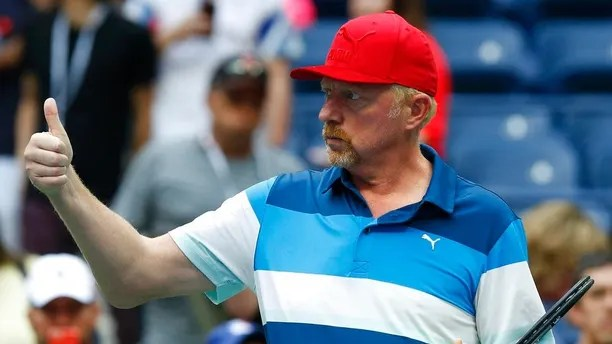 FILE - In this file photo dated Friday, Sept. 2, 2016, Boris Becker motions as he watches Novak Djokovic, of Serbia, practice during the third round of the U.S. Open tennis tournament, in New York. Lawyers for Becker claimed in Britain's High Court late Thursday June 14, 2018, that Becker's role as a sports attache for the Central African Republic gives him diplomatic immunity from bankruptcy proceedings.(AP Photo/Jason DeCrow, FILE)