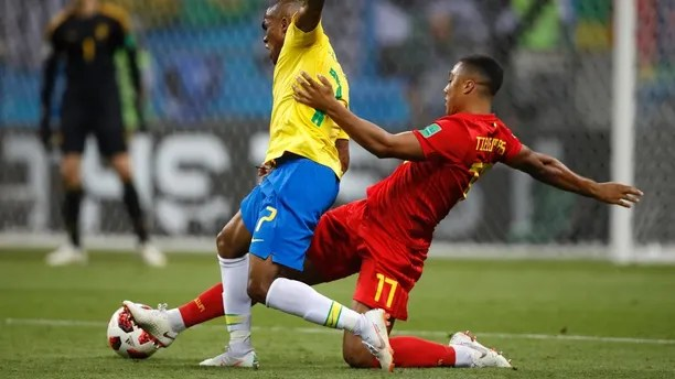 Brazil's Douglas Costa, left, is tackled by Belgium's Youri Tielemans during the quarterfinal match between Brazil and Belgium at the 2018 soccer World Cup in the Kazan Arena, in Kazan, Russia, Friday, July 6, 2018. (AP Photo/Francisco Seco)