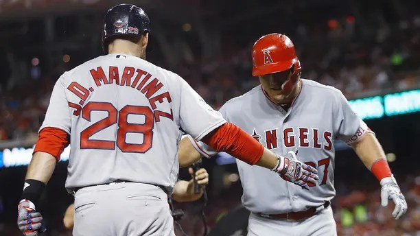 Los Angeles Angels of Anaheim outfielder Mike Trout (27) is welcomed at the dugout by Boston Red Sox's J.D. Martinez (28) after his solo home run during the third inning of the Major League Baseball All-Star Game, Tuesday, July 17, 2018, in Washington. (AP Photo/Patrick Semansky)