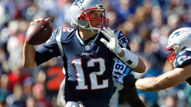 File photo - New England Patriots quarterback Tom Brady passes the ball during the first quarter against the Carolina Panthers at Gillette Stadium on Oct 1, 2017.  (Stew Milne-USA Today Sports)