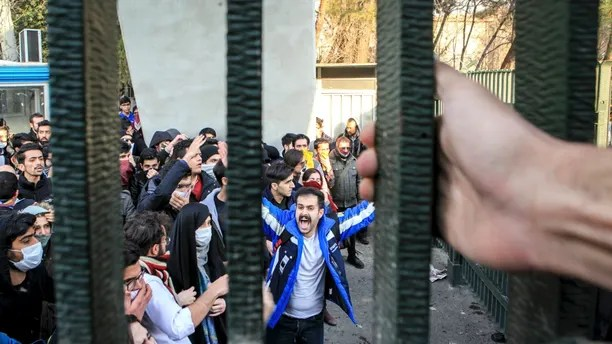 FILE - In this Dec. 30, 2017 file photo, taken by an individual not employed by the Associated Press and obtained by the AP outside Iran, university students attend an anti-government protest inside Tehran University, in Tehran, Iran. As nationwide protests have shaken Iran over the last week, the Islamic Republic increasingly has blamed its foreign foes for fomenting the unrest. So far though, there�s no direct evidence offered by Tehran to support that claim. (AP Photo, File)