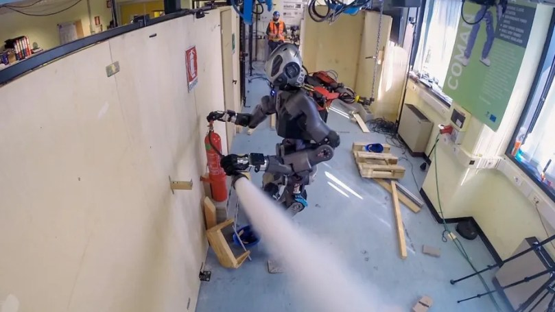 The WALK-MAN humanoid robot has been developed to support emergency response teams. The robot is also able to activate an extinguisher to eliminate the fire. (CREDIT IIT-Istituto Italiano di Tecnologia)