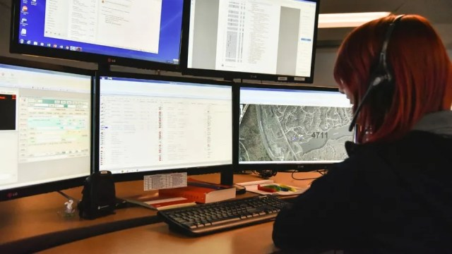 In this photo taken March 15, 2018, a dispatcher in Roswell, Ga., works with a variety of screens while handling a 911 call. The Roswell call center is one of the few in the United States that accepts text messages. This year is the 50th anniversary of the first 911 call placed in the United States and authorities say it is in desperate need to have its technology modernized. (AP Photo/Lisa Marie Pane)