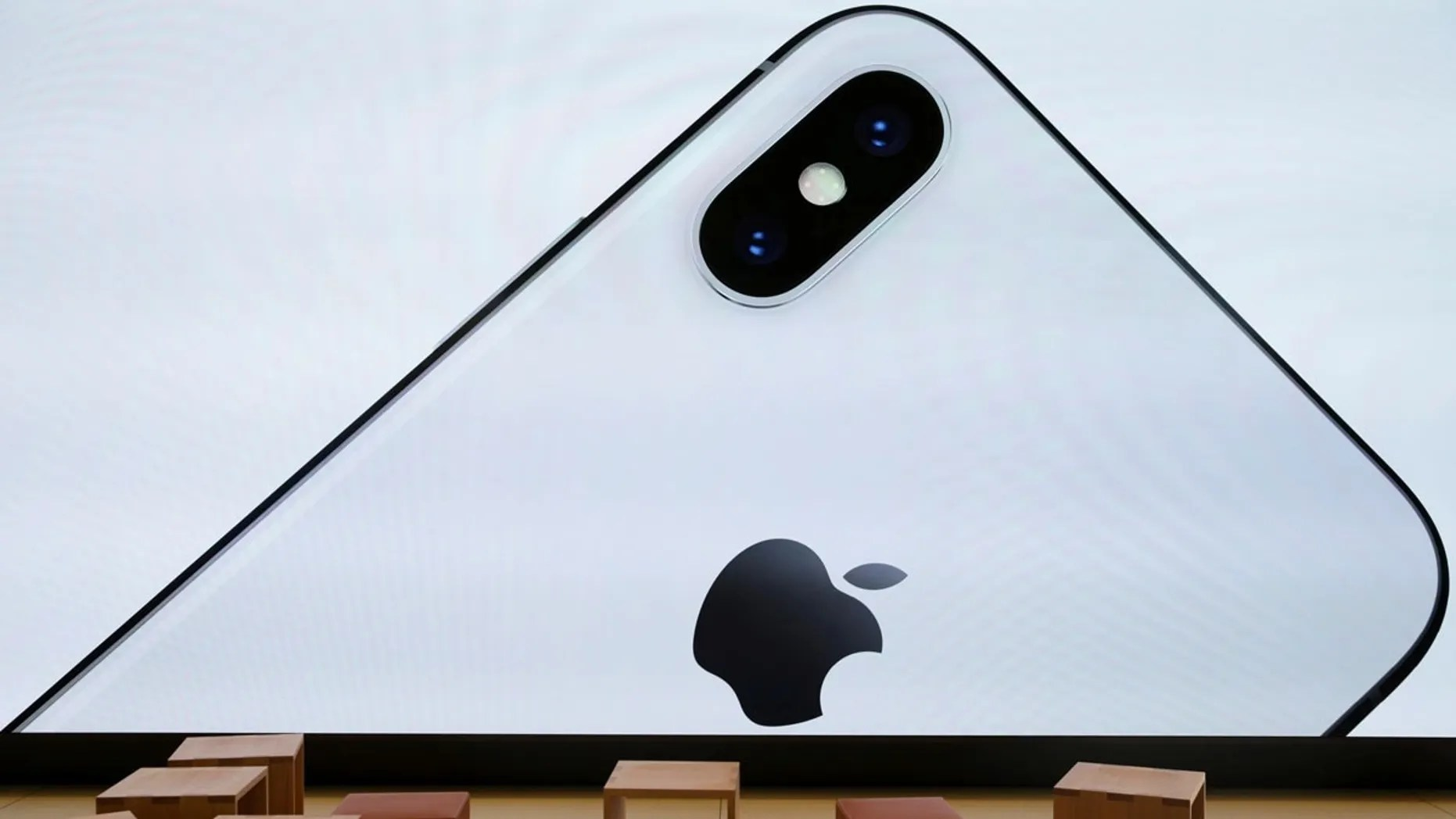 File photo: An iPhone X is seen on a large video screen in the new Apple Visitor Center in Cupertino, California, U.S., November 17, 2017. REUTERS/Elijah Nouvelage