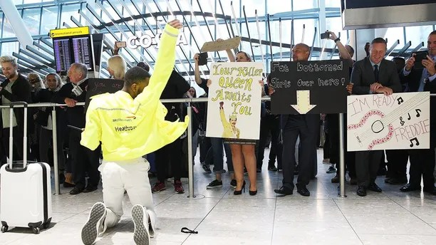 FREE FOR EDITORIAL USE - FREDDIE FOR TAKE-OFF! British Airways and Heathrow baggage handlers perform tributes to one-time Heathrow baggage handler Freddie Mercury for the Queen legend's September 5th birthday celebrations at Heathrow T5. The baggage handlers have been taking professional choreography lessons learning a full routine to 'I Want To Break Free'  as part of a special celebration ahead of the release of BOHEMIAN RHAPSODY, the new Queen movie released on October 24th.