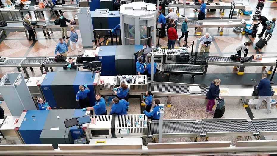 A TSA representative is being praised for assisting a male after he collapsed during a airport.