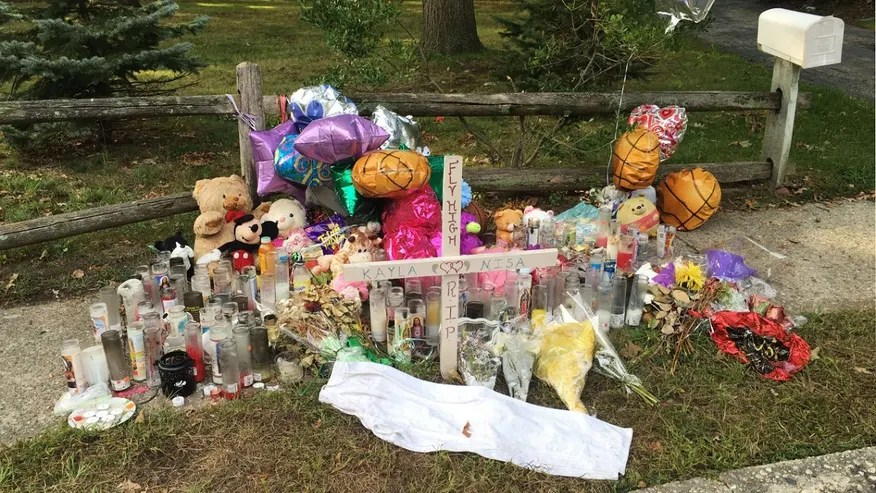 In this Sept. 27, 2016 photo, a memorial for Nisa Mickens and Kayla Cueva is located near the locations where their bodies were found in Brentwood, N.Y.