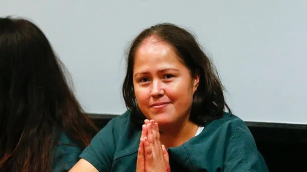 Isabel Martinez gestures towards news cameras during her first court appearance Friday, July 7, 2017, in Lawrenceville , Ga. Martinez is charged with killing four of her children and their father. (AP Photo/John Bazemore)