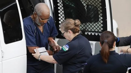 James Mathew Bradley Jr., 60, of Clearwater, Fla., left, arrives at the federal courthouse for a hearing, Monday, July 24, 2017, in San Antonio. Bradley was taken into custody and is expected to be charged in connection to the people who died after being crammed into a sweltering tractor-trailer found parked outside a Walmart in the midsummer Texas heat Sunday, according to authorities in what they described as an immigrant-smuggling attempt gone wrong. (AP Photo/Eric Gay)