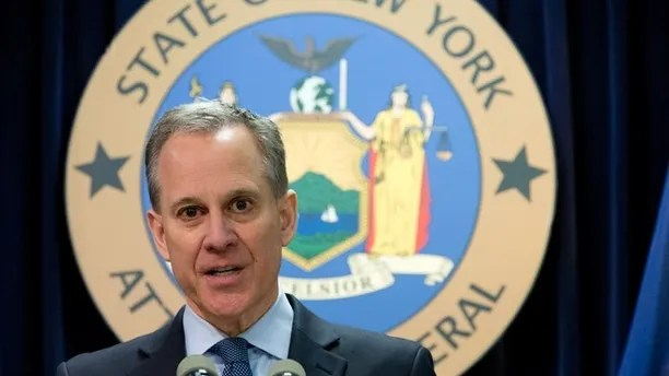 FILE - In this Feb. 11, 2016 file photo, New York Attorney General Eric T. Schneiderman speaks during a news conference in New York. A suburban New York school district has agreed to change its policies after being found that it denied or delayed access to students arriving from Central and South America and elsewhere. Schneiderman says the Westbury School District on Long Island is now the 22nd district to change policies involving immigrant students. (AP Photo/Mary Altaffer, File)