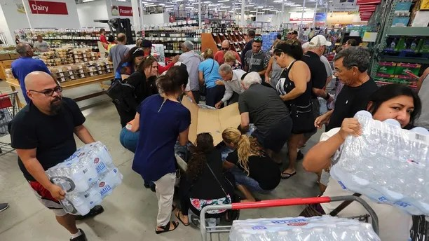 Residents purchase water at BJ Wholesale in preparation for Hurricane Irma Tuesday, Sept. 5, 2017, in Miami. Hurricane Irma grew into a dangerous Category 5 storm, the most powerful seen in the Atlantic in over a decade, and roared toward islands in the northeast Caribbean Tuesday on a path that could eventually take it to the United States.   (Roberto Koltun/Miami Herald via AP)