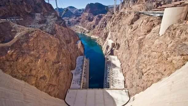 From the center of the Hoover Dam on the border of Nevada-Arizona, this view shows the Colorado River and the new bypass bridge under construction.