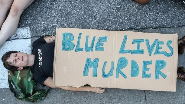"""A protester participates in a """"Die-In""""  during a second day of demonstrations after a not guilty verdict in the murder trial of former St. Louis police officer Jason Stockley, charged with the 2011 shooting of  Anthony Lamar Smith, who was black, in St. Louis, Missouri, U.S., September 16, 2017.  Photo taken September 16, 2017.  REUTERS/Lawrence Bryant - RC1B82FFA4C0"""