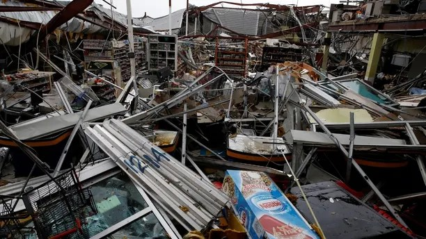Damages are seen in a supermarket after the area was hit by Hurricane Maria in Guayama, Puerto Rico September 20, 2017. REUTERS/Carlos Garcia Rawlins - RC147B4E6DA0