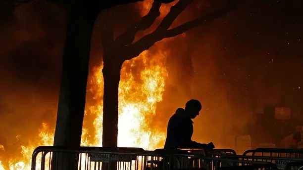 "CORRECTS TO OMIT ANN COULTER- FILE - In this Feb. 1, 2017 file photo, a fire set by demonstrators protesting a scheduled speaking appearance by Breitbart News editor Milo Yiannopoulos burns on Sproul Plaza on the University of California, Berkeley campus. Right-wing showman Milo Yiannopoulos is holding a ""Free Speech Week"" at the University of California, Berkeley with a planned lineup including conservative firebrands Steve Bannon. The university says it has no confirmation the headline acts will appear but is preparing strong security to head off any more violent protests at the liberal campus. (AP Photo/Ben Margot, File)"