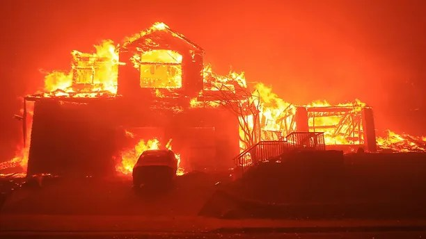 A home burns in Fountaingrove, Monday Oct. 9, 2017 in Santa Rosa, Calif. More than a dozen wildfires whipped by powerful winds been burning though California wine country. The flames have destroyed at least 1,500 homes and businesses and sent thousands of people fleeing. (Kent Porter/The Press Democrat via AP)