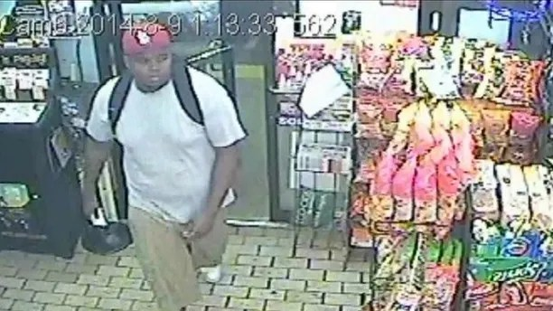 Michael Brown is seen entering the Ferguson Market hours before the unarmed 18 year old was shot dead by a police officer, in a still image from a previously undisclosed store surveillance video in Ferguson, Missouri August 9, 2014. St Louis County Prosecutor/Handout via REUTERS FOR EDITORIAL USE ONLY. NO RESALES. NO ARCHIVES     TPX IMAGES OF THE DAY - RTX30VFG