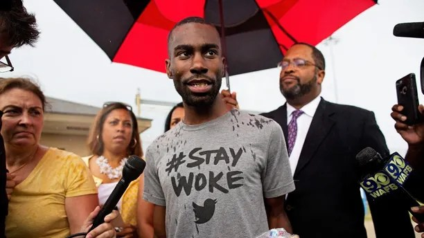 FILE - In this July 10, 2016, file photo, Black Lives Matter activist DeRay Mckesson talks to the media after his release from the Baton Rouge jail in Baton Rouge, La. U.S. District Judge Brian Jackson said he intends to dismiss a lawsuit that accuses Black Lives Matter and several movement leaders of inciting violence that led to a gunman's deadly ambush of law enforcement officers in Baton Rouge last year. Thursday, Sept. 28, 2017, Jackson threw out a police officer's lawsuit blaming Mckesson for injuries he sustained during a protest over a deadly police shooting in Baton Rouge last year. (AP Photo/Max Becherer, File)