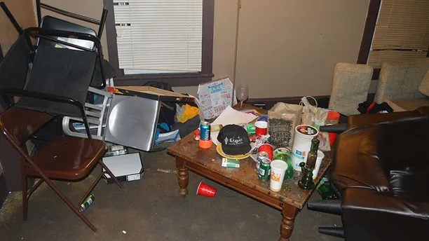 In this Nov. 29, 2017 photo provided by the Brockport Police Department in Brockport, N.Y., filthy conditions at a house belonging to an unsanctioned fraternity near Brockport College are shown. Police arrested members of the unrecognized fraternity at the New York state college on Thursday, Dec. 7, 2017. Charges included various misdemeanor counts of hazing, criminal nuisance, assault and alcohol-related unlawfully dealing with a child. One of the men was charged with criminal possession of a controlled substance and two with animal cruelty. (Brockport Police Department via AP)