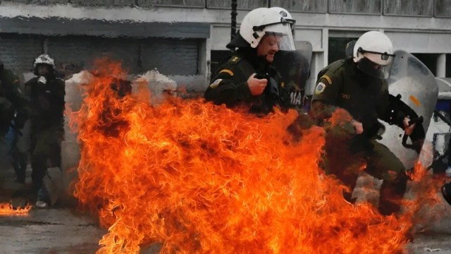 A radical, left-wing student group at the University of Texas posted a photo of a police officer on fire -- similar to the shot here from 2016 protests in Greece.