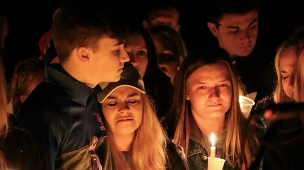 People attend a vigil for the victims of a fatal shooting at Marshall County High School on Thursday, January 25, 2018 at Mike Miller County Park. Benton, Ky. The 15-year-old, accused of fatal shooting on Tuesday, which left more than a dozen wounded, was ordered on Thursday on preliminary charges of murder and badault. (AP Photo / Robert Ray)