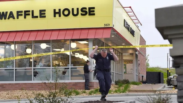 Law enforcement officials work the scene of a fatal shooting at a Waffle House in the Antioch neighborhood of Nashville, Sunday, April 22, 2018. (George Walker IV/The Tennessean via AP)