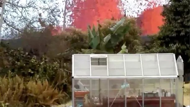 Lava is seen from a fissure appearing behind a resident's backyard in Puna, Hawaii, U.S. in this still frame taken from May 6, 2018 video obtained from social media.  KEITH BROCK/Social Media via REUTERS   ATTENTION EDITORS. THIS IMAGE HAS BEEN SUPPLIED BY A THIRD PARTY. MANDATORY CREDIT. NO RESALES. NO ARCHIVES. MUST ON SCREEN COURTESY KEITH BROCK. - RC1857FE2AC0