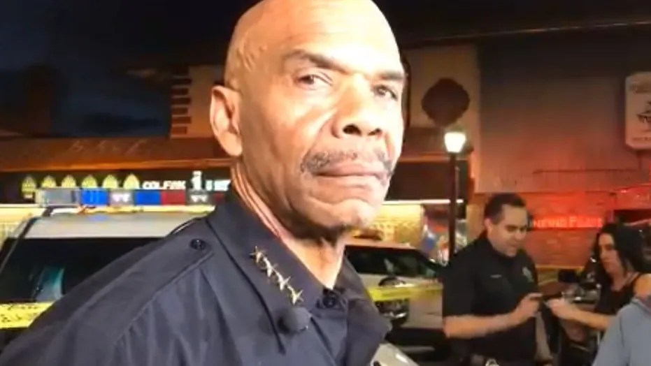 Denver police Chief Robert White briefs the media after an officer was shot in the leg.