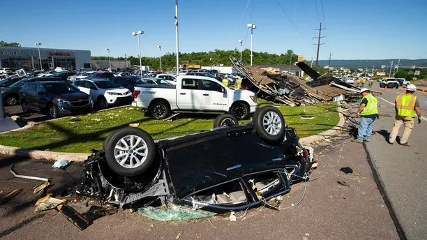 A Nissan sedan on the lot at Ken Pollock Nissan dealership in Wilkes-Barre Twp., Pa. is destroyed on Thursday, June 14, 2018 after a strong storm moved through the area on Wednesday night. A powerful storm has pounded parts of Pennsylvania, damaging buildings, overturning cars and downing trees and power lines. (Christopher Dolan/The Citizens' Voice via AP)