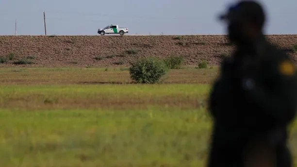 FILE - In this Aug. 11, 2017, file photo, U.S. Customs and Border Patrol agents patrol for immigrants suspected of crossing into the United States illegally along the Rio Grande near Granjeno, Texas. A U.S. official tells The Associated Press that Border Patrol arrests fell sharply in June 2018 to the lowest level since February, ending a streak of four straight monthly increases. The drop may reflect seasonal trends or it could signal that President Donald Trump's