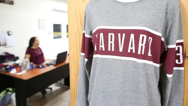 A sweatshirt with the name of Harvard University is seen at the factory of League Collegiate Outfitters, a manufacturer for sportswear for U.S. colleges, in Ciudad Arce, El Salvador, August 9, 2017. Picture taken August 9, 2017. REUTERS/Jose Cabezas - RC1991554BB0
