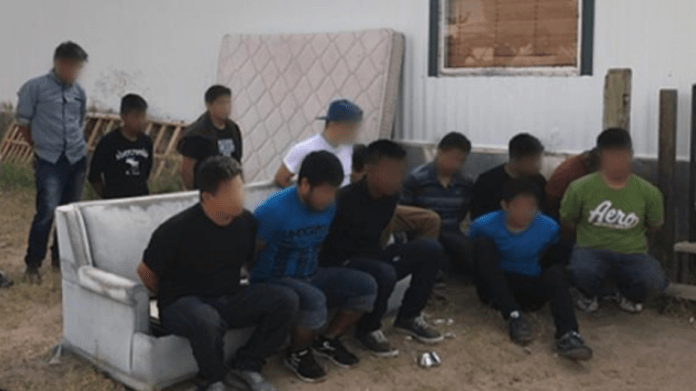 US immigration and customs officials arrested 18 people smugglers and 117 illegal immigrants in June.