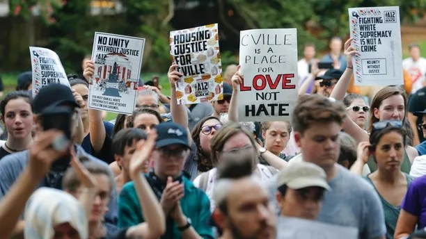 Demonstrators march on the campus of the University of Virginia in anticipation of the anniversary of last year's Unite the Right rally in Charlottesville, Va., Saturday, Aug. 11, 2018. (AP Photo/Steve Helber)