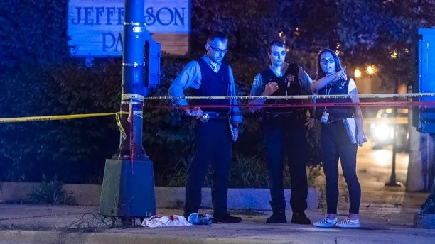 Chicago Police investigate the scene where someone was shot Sunday, Aug. 19, 2018, in Chicago. (Tyler LaRiviere/Chicago Sun-Times via AP)