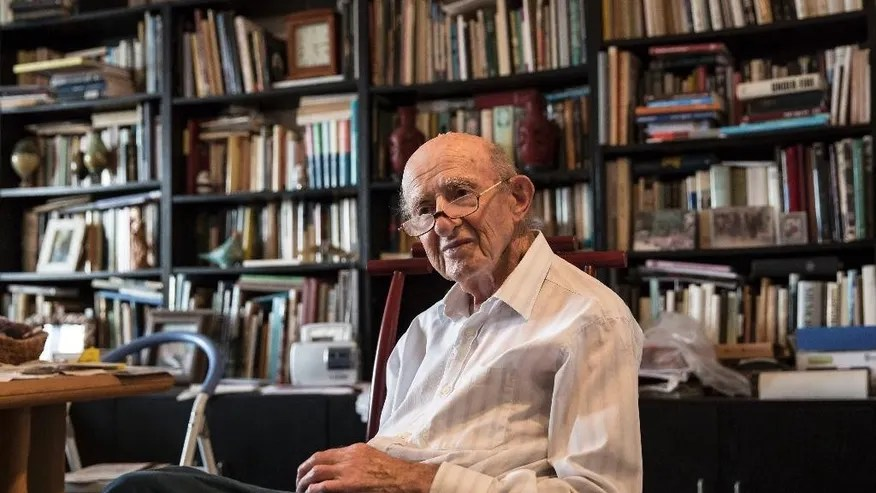 "In this photo made on Monday, May 23, 2016, Joseph Harmatz sits during an interview with the Associated Press at his apartment in Tel Aviv, Israel. Harmatz is one of the few remaining Jewish ""Avengers"" who carried out a mass poisoning of former SS men in an American prisoner-of-war camp in 1946 after World War II. The poisoning sickened more than 2,200 Germans but ultimately caused no known deaths.(AP Photo /Tsafrir Abayov)"