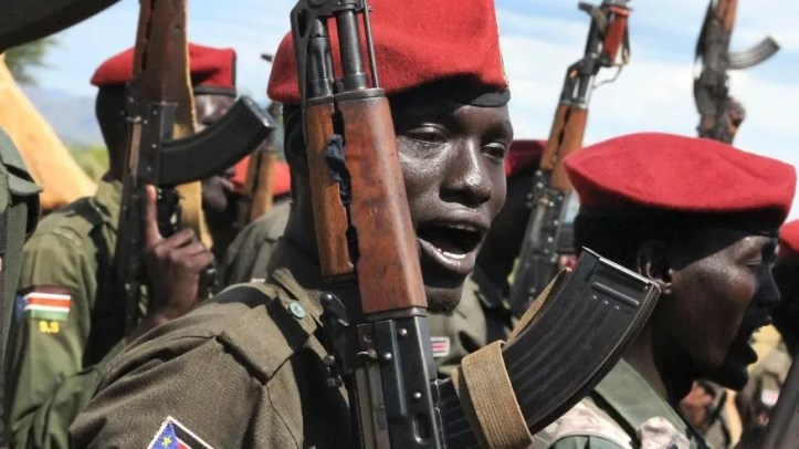 File - In this file photo taken Thursday, April 14, 2016, government soldiers follow orders to raise their guns during a military parade in Juba, South Sudan. Escalating violence in South Sudan is casting a light on Israel's murky involvement in that raging conflict, with the government's use of Israeli arms and surveillance equipment drawing criticism from human rights activists and a lawmaker who are demanding that Israel halt such transfers to the embattled African country. The scrutiny comes as Israel has been forging new ties with countries across Africa, hoping their support will counter Palestinian diplomatic offensives at the United Nations.(AP Photo/Justin Lynch, File)