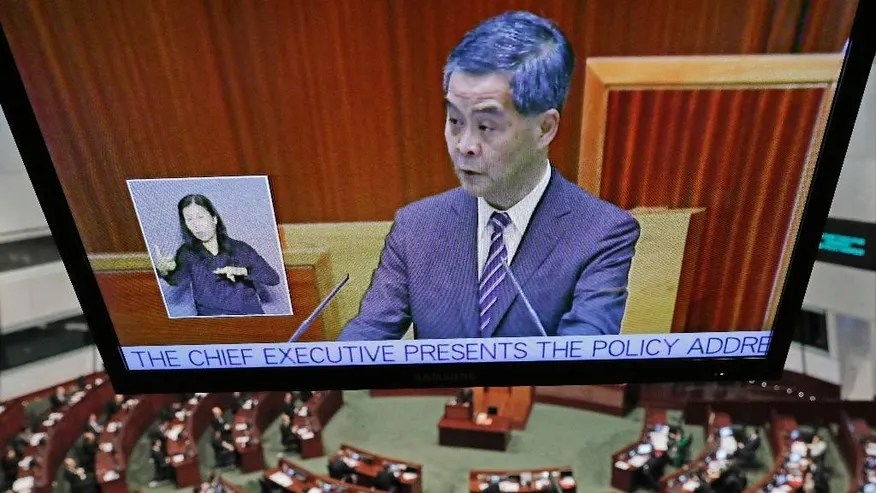 A video screen shows Hong Kong's Chief Executive Leung Chun-ying giving his final policy speech at the Legislative Council in Hong Kong, Wednesday, Jan. 18, 2017. Hong Kong's outgoing leader has issued a warning in his farewell policy speech to those advocating independence for the Chinese-controlled territory. (AP Photo/Vincent Yu)