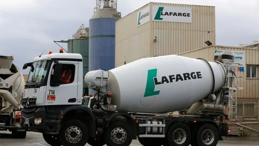 The logo of French building material Lafarge is seen on cement trucks at a production plant in Paris, France, February 22, 2016.