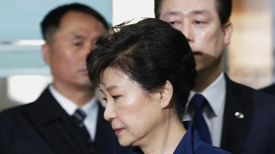 FILE - In this March 30, 2017 file photo, ousted South Korean President Park Geun-hye arrives at the Seoul Central District Court for hearing on a prosecutors' request for her arrest for corruption, in Seoul, South Korea.  The arrest of South Korea's first female president marks a stunning fall for the scion of a powerful general who himself ruled the country during her teenage years and into her 20s. Park was jailed Friday, March 31, 2017,  three weeks after the Constitutional Court stripped her of office over a corruption scandal. Prosecutors accuse her of colluding with a jailed confidante to amass an illicit fortune and allowing the friend to manipulate state affairs.  (AP Photo/Ahn Young-joon, File)