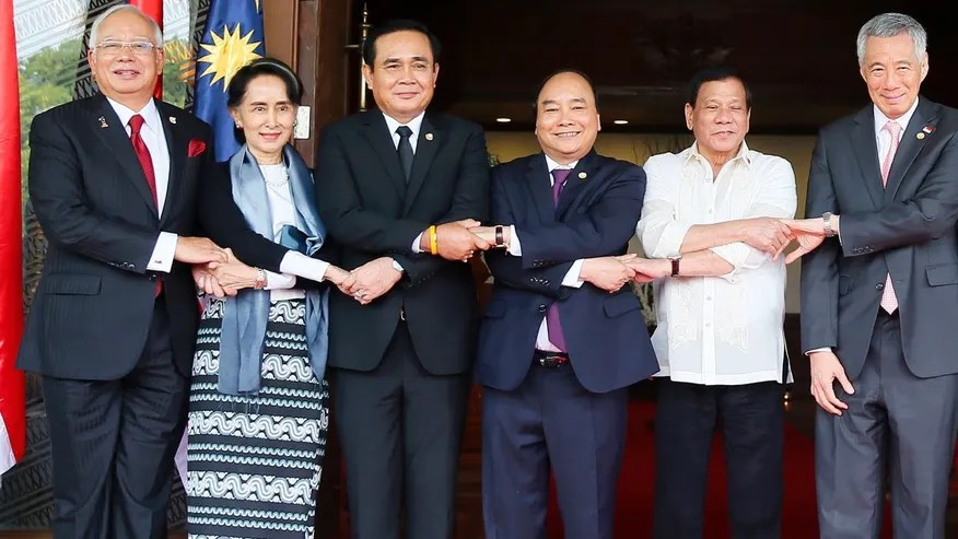"Southeast Asian leaders link arms the ""ASEAN Way"" as they pose for a group photo following their retreat in the 30th ASEAN Leaders' Summit Saturday, April 29, 2017, in Manila, Philippines."