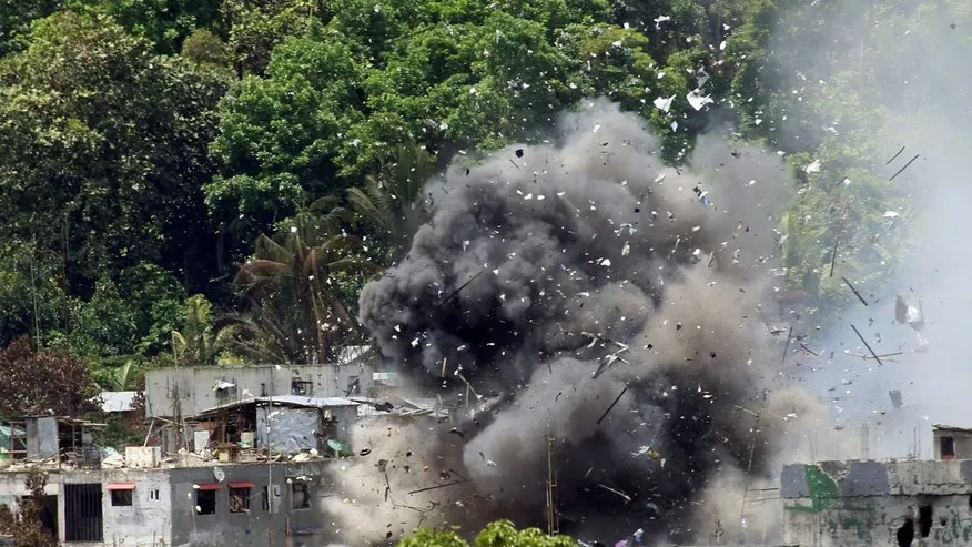 June 20: Debris and smoke are seen after an OV-10 Bronco aircraft released a bomb during an airstrike, as government forces continue their assault against insurgents from the Maute group, who have taken over large parts of Marawi City.