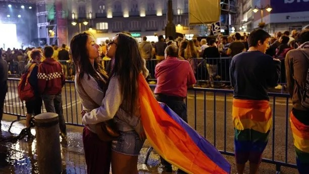 Women embrace while attending a concert in the Plaza Puerta del Sol, Friday, June 30, 2017 in Madrid. The city is celebrating WorldPride 2017, a colorful mixture of vindication for sexual and gender diversity and all-night partying. Up to 3 million people are expected in the Spanish capital amid tight security measures. (AP Photo/Mark Lennihan)