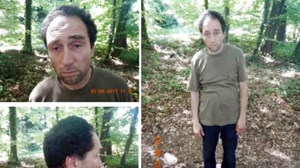 This undated images released by the KAPO Schaffhausen shows the alleged attacker who injured several people in Schaffhausen Switzerland Monday, July 24, 2017. An unkempt man armed with a chainsaw wounded five people Monday at an office building in the northern Swiss city of Schaffhausen and then fled, police said. A manhunt was on for him. (KAPO Schaffhausen via AP)