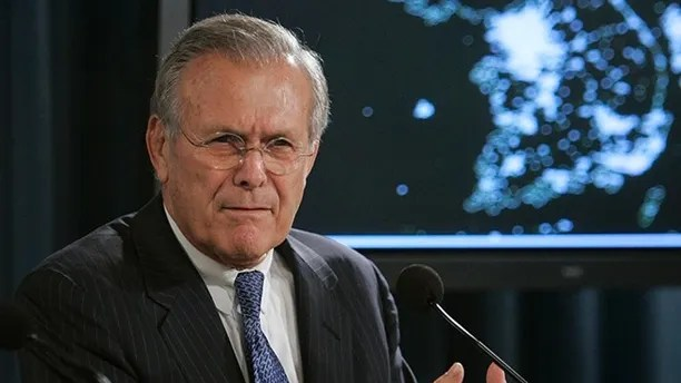 With a map of the Korean Peninsula behind him, Defense Secretary Donald H. Rumsfeld gestures during a press briefing at the Pentagon, Wednesday, Oct. 11, 2006. (AP Photo/Evan Vucci)