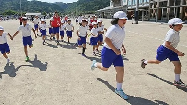 Children and residents conduct an evacuation drill on the assumption that North Korea may launch ballistic missile in Abu, Yamaguchi Prefecture on June 04, 2017. Participants simulated evacuating to gymnastic hall promptly. ( The Yomiuri Shimbun via AP Images )