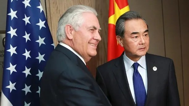 Chinese Foreign Minister Wang Yi , right, and US Secretary of State Rex Tillerson pose for a photograph during their bilateral meeting on the sidelines of the 50th Association of Southeast Asian Nations (ASEAN) Regional Forum (ARF) in Pasay City southeast of Manila, Philippines, Sunday, Aug. 6, 2017. (Rouelle Umali/Pool Photo via AP)