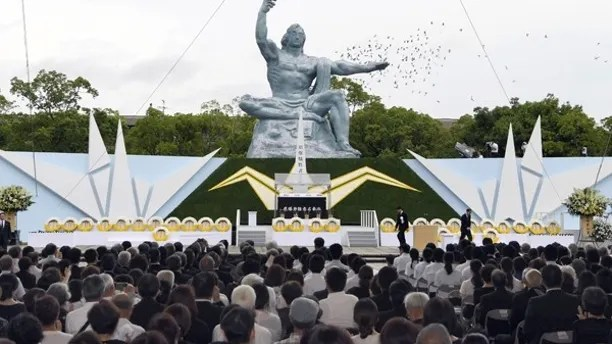 Doves fly over the Statue of Peace at Nagasaki Peace Park in Nagasaki, southern Japan during a ceremony to mark the 72nd anniversary of the world's second atomic bomb attack over the city, Wednesday, Aug. 9, 2017. (Nozomu Endo/Kyodo News via AP)