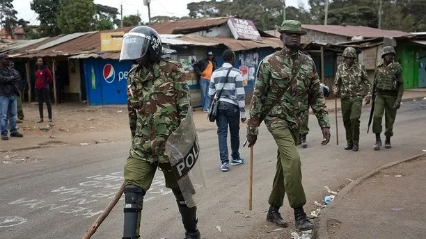 Kenyan security forces patrol the Kibera area of Nairobi, Kenya, Saturday Aug. 12, 2017. Violent demonstrations have erupted in some areas after President Uhuru Kenyatta was declared victorious of the presidential election. (AP Photo/Jerome Delay)