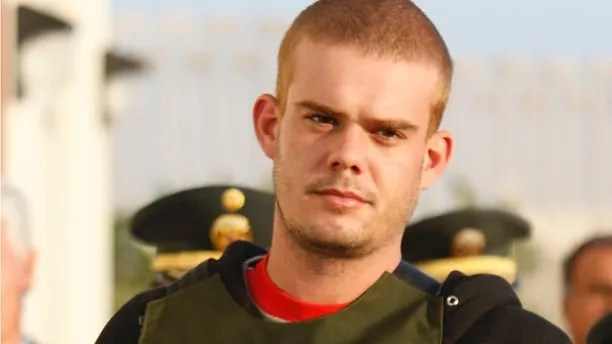 FILE - In this June 4, 2010 file photo, Joran Van der Sloot, top, is escorted by police officers outside a Peruvian police station, near the border with Chile in Tacna, Peru. A lawyer for Van Der Sloot said on Monday, April 23, 2012, Peru is evaluating a request by the United States to extradite the jailed Dutchman, who is the main suspect in the 2005 disappearance of Natalee Holloway in Aruba. Van der Sloot is serving a 28-year sentence in Peru for killing a woman he met in a Lima casino. (AP Photo/Karel Navarro, File)